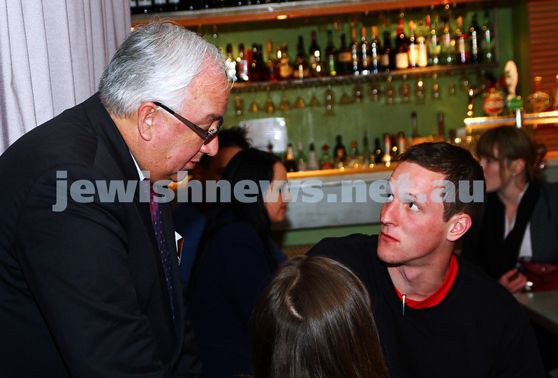 7-9-13. Election day 2013. Member for Melbourne Ports, Michael Danby talks with one of his supporters on election night while waiting for results. Photo: Peter Haskin