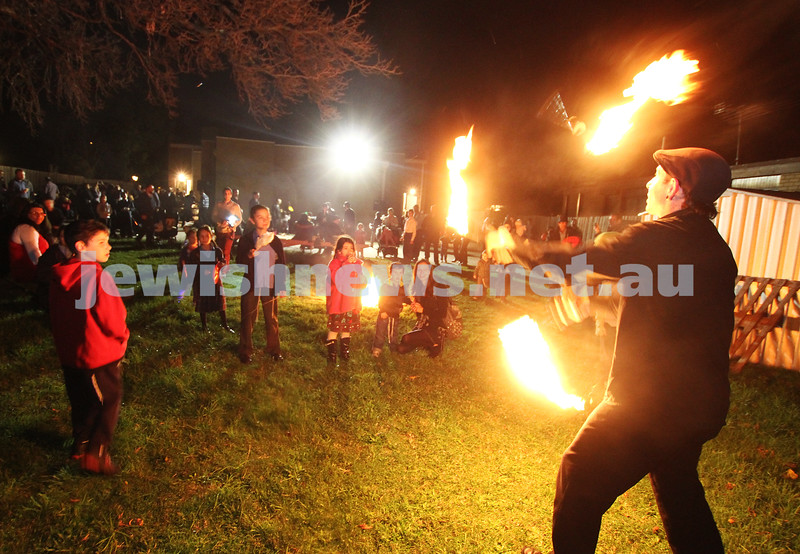 9-5-12. Lag B'omer 2012. Fire juggler at Katanga . Photo: Peter Haskin