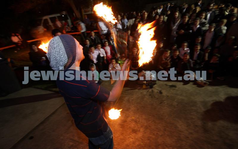 1/5/10. Lag B'omer celebrations at Katanga. Fire juggler Ben Weinstein. Photo: Peter Haskin