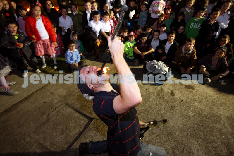 1/5/10. Lag B'omer celebrations at Katanga. Fire juggler Ben Weinstein. Photo: Peter Haskin