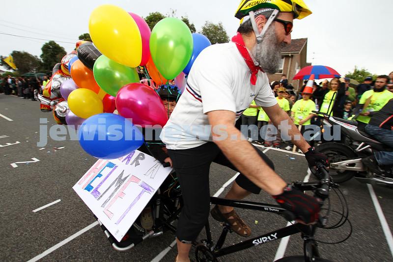 22-5-11. Chabad Youth Lag B'omer Parade 2011. Shlomo Werdiger promotes safe cycling. Photo: Peter Haskin