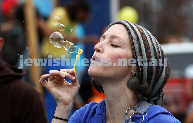 22-5-11. Chabad Youth Lag B'omer Parade 2011. Reveller from the Israeli Travellers float. Photo: Peter Haskin