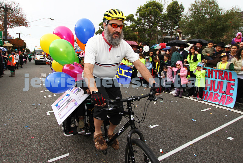 22-5-11. Chabad Youth Lag B'omer Parade 2011. Shlomo Werdiger promoting safe cycling. Photo: Peter Haskin