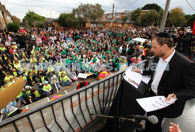 22-5-11. Chabad Youth Lag B'omer Parade 2011. Moshe Kahn addresses the crowd. Photo: Peter Haskin