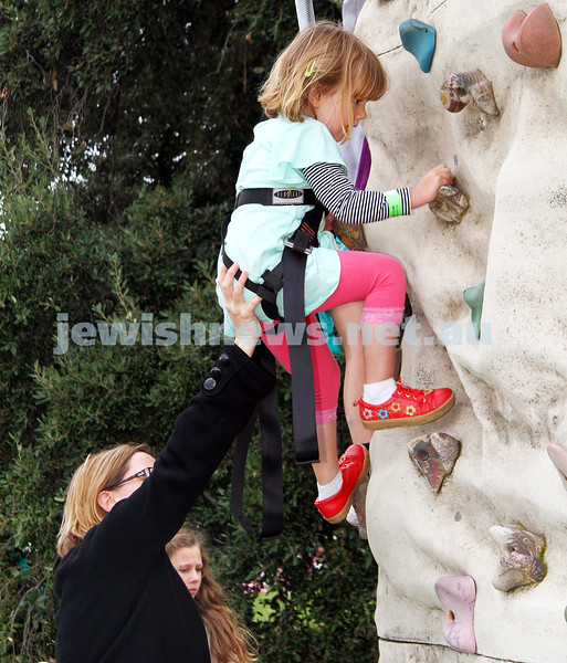 22-5-11. Chabad Youth Lag B'omer Fair at Princes Park 2011. Mum lends a helping hand. Photo: Peter Haskin