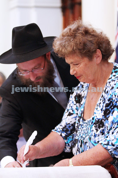 29-1-12. East Melbourne Hebrew Congregation. Double Torah dedication at Queens Hall, Parliament House, Victoria with Cheif Rabbi Lord Jonathan Sacks in attendance.  Final letters of the torah with Rabbi Eli Gutnick. Photo: Peter Haskin.