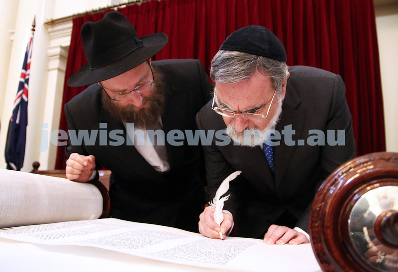 29-1-12. East Melbourne Hebrew Congregation. Double Torah dedication at Queens Hall, Parliament House, Victoria with Cheif Rabbi Lord Jonathan Sacks in attendance.  Lord Sacks fillin gin last letter with Rabbi Eli Gutnick. Photo: Peter Haskin.