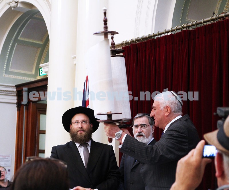 29-1-12. East Melbourne Hebrew Congregation. Double Torah dedication at Queens Hall, Parliament House, Victoria with Chief Rabbi Lord Jonathan Sacks in attendance. Leon Sossen holds the torah up. Photo: Peter Haskin.