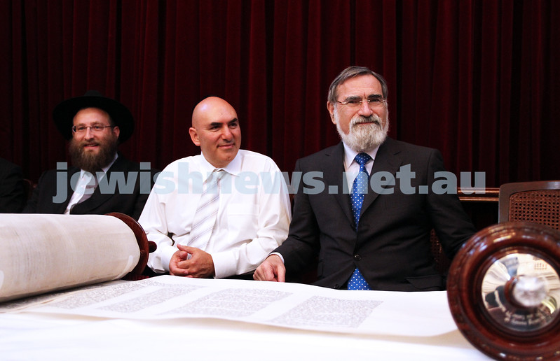 29-1-12. East Melbourne Hebrew Congregation. Double Torah dedication at Queens Hall, Parliament House, Victoria with Cheif Rabbi Lord Jonathan Sacks in attendance.  From left: Rabbi Eli Gutnick (scribe), EMHC President Danny Segal, Lord Jonathan Sacks. Photo: Peter Haskin.