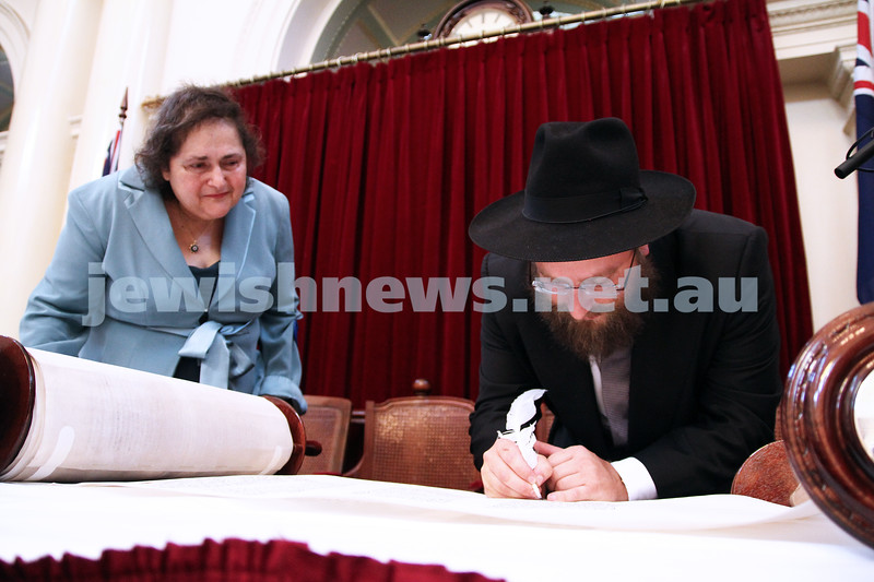 29-1-12. East Melbourne Hebrew Congregation. Double Torah dedication at Queens Hall, Parliament House, Victoria with Cheif Rabbi Lord Jonathan Sacks in attendance.  Rabbi Eli Gutnick filling in one of the last letters on the new torah. Photo: Peter Haskin.