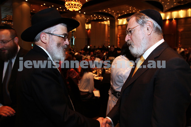 29-1-12. Gala dinner at Crown's Paladium Room for Chief Rabbi Lord Jonathan Sacks. Rabbi Joseph Gutnick (left), Lord Jonathan Sacks. Photo: Peter Haskin.