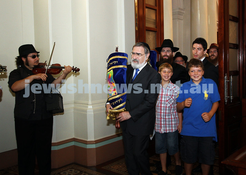 29-1-12. East Melbourne Hebrew Congregation. Double Torah dedication at Queens Hall, Parliament House, Victoria with Chief Rabbi Lord Jonathan Sacks in attendance. Lord Sacks carries one of the torah's out of Queens Hall, ready for the procession. Photo: Peter Haskin.