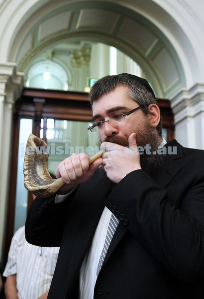 29-1-12. East Melbourne Hebrew Congregation. Double Torah dedication at Queens Hall, Parliament House, Victoria with Chief Rabbi Lord Jonathan Sacks in attendance. Rabbi Avraham Jacks blows the shofar. Photo: Peter Haskin.