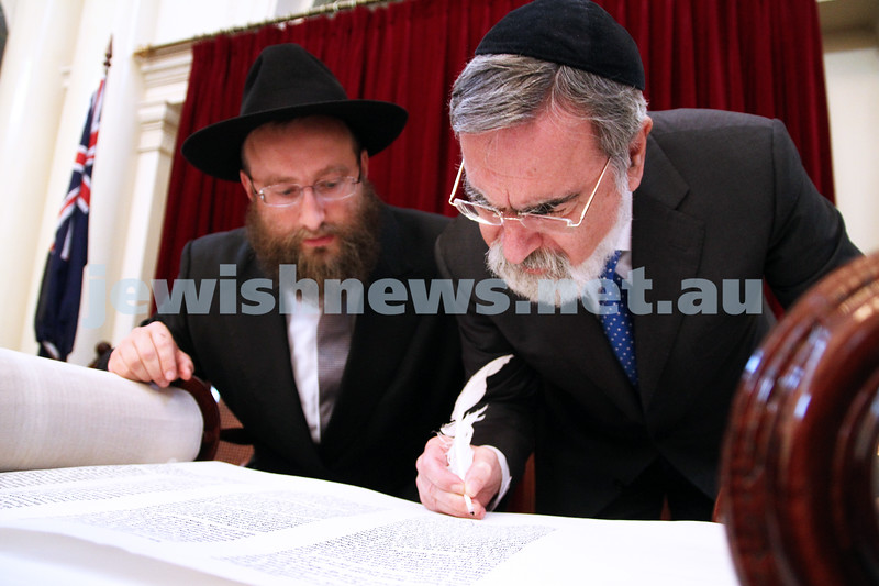 29-1-12. East Melbourne Hebrew Congregation. Double Torah dedication at Queens Hall, Parliament House, Victoria with Cheif Rabbi Lord Jonathan Sacks in attendance.  Lord Sacks filling in last letter of torah with Rabbi Eli Gutnick. Photo: Peter Haskin.