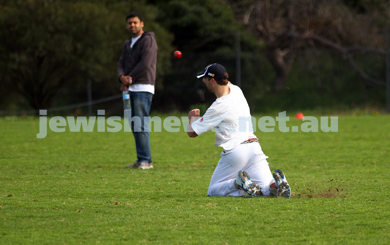 9-10-11. Maccabi Cricket v RMIT. David Fayman fires in a return. Photo: Peter Haskin