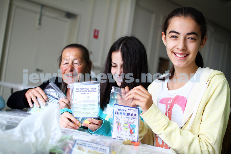 25-11-12. Mitzvah Day 2012. Volunteers at Caulied Shul packing Chanukah bags for Jewish Care. Photo: Peter Haskin