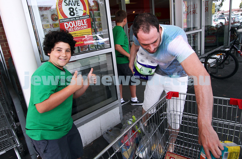 25-11-12. Mitzvah Day 2012. Isaac Zahavi thanks a Coles shopper for the food donation.  Photo: Peter Haskin