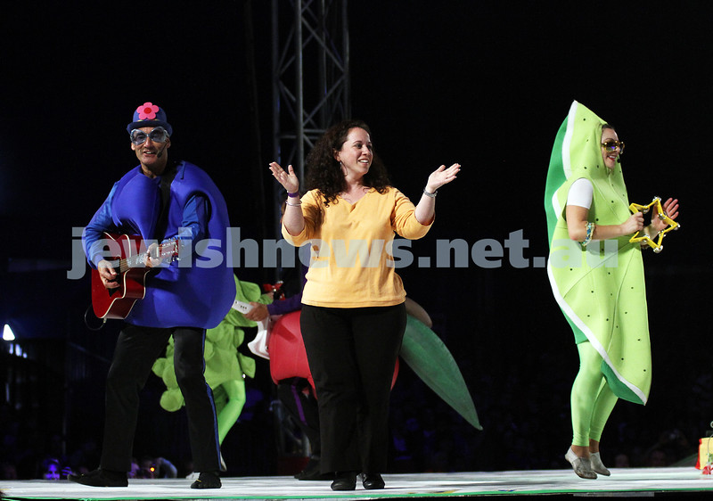 """2-12-11. The Wiggles. Tammy Cohen on stage with the Wiggles at the Flemington racecourse in Melbourne singing """"Fruit Salad"""". Tammy won a competition to be the 5th Wiggle. Photo: Peter Haskin"""