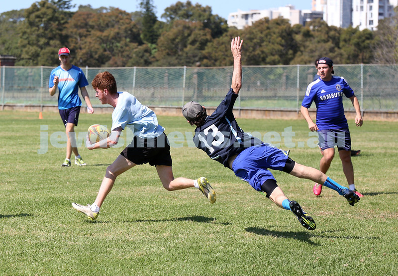 Maccabi Touch Footy competition at Centennial Park. Team Mac Touch vs Siroburgess. Jake Rosengarten runs past Tom Weiner who attempts a dive to tip him.