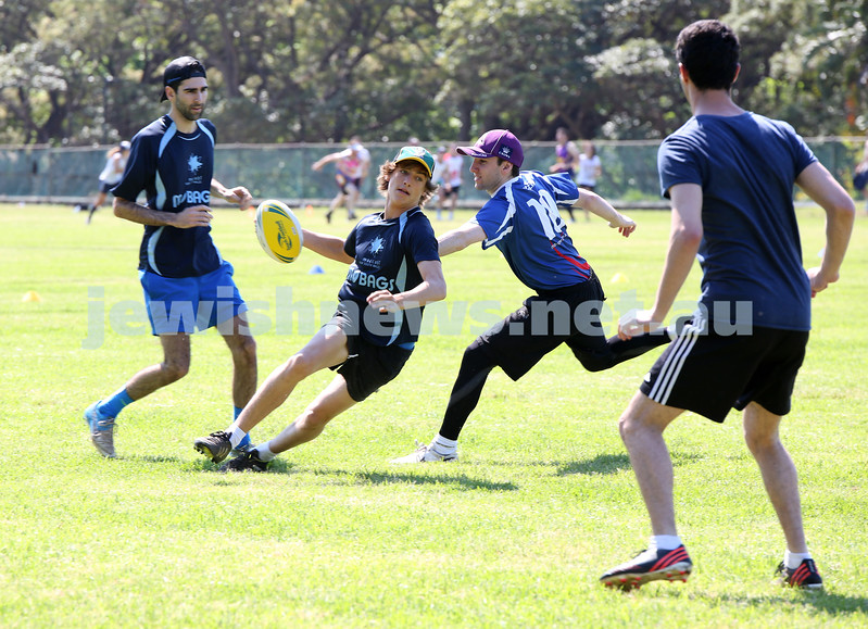 Maccabi Touch Footy competition at Centennial Park. Team Mac Touch vs Siroburgess. Zak Michael is tipped by Peter Milson as Joel Weiner (L) looks on.