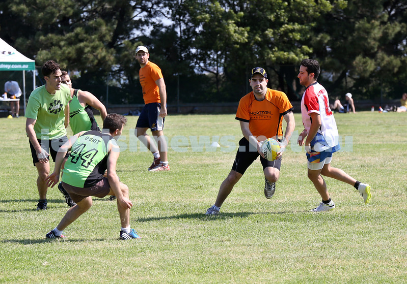 Maccabi Touch Footy competition at Centennial Park. Horizon Habitats (orange) vs Prestige Worldwide (green). Simon Molner with the ball is blocked by Jack and Max Symonds.