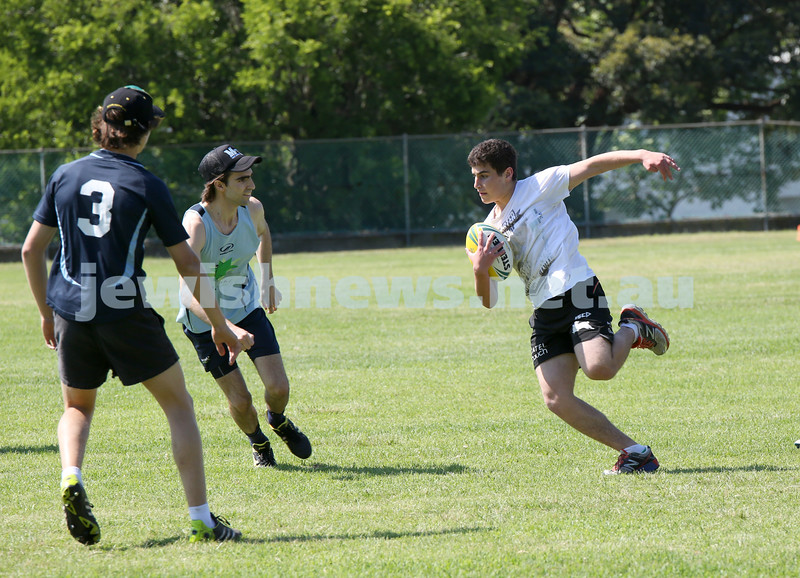 Maccabi Touch Footy competition at Centennial Park. Team Mac Touch vs Siroburgess. Jonathon Stern from team Mac Touch attempts to outrun David Weiner and Zak Michael.