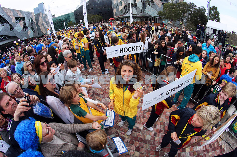 22-8-12. A packed Federation Square in Melbourne welcomes home Australia's medalists from the London 2012 Olympics. Jewish silver medalist in the Kayak, Jessica Fox holds her medal up for the camera. Photo: Peter Haskin