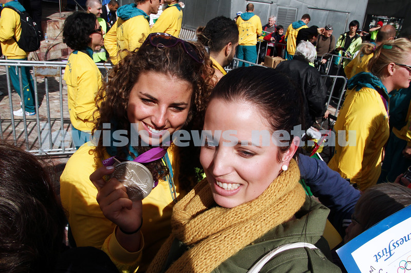 22-8-12. A packed Federation Square in Melbourne welcomes home Australia's medalists from the London 2012 Olympics. Jewish silver medalist Jessica Fox having her photo taken with a fan. Photo: Peter Haskin