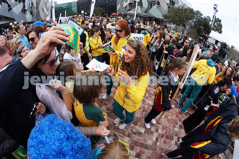 22-8-12. A packed Federation Square in Melbourne welcomes home Australia's medalists from the London 2012 Olympics. Jewish silver medalist in the Kayak, Jessica Fox signing autographs.  Photo: Peter Haskin