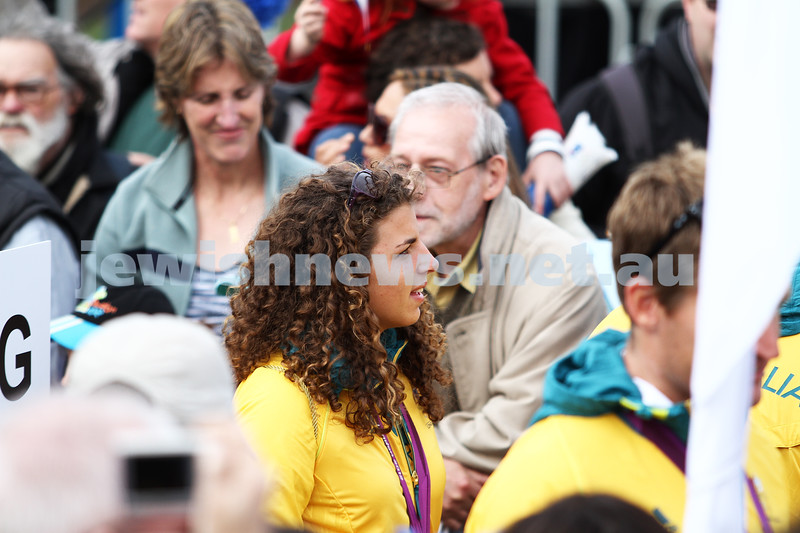 22-8-12. A packed Federation Square in Melbourne welcomes home Australia's medalists from the London 2012 Olympics. Jessica Fox walking through the crowd.  Photo: Peter Haskin