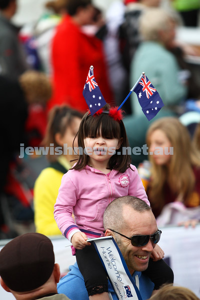 22-8-12. A packed Federation Square in Melbourne welcomes home Australia's medalists from the London 2012 Olympics. One of the yunger fans showing her support for the athletes. Photo: Peter Haskin