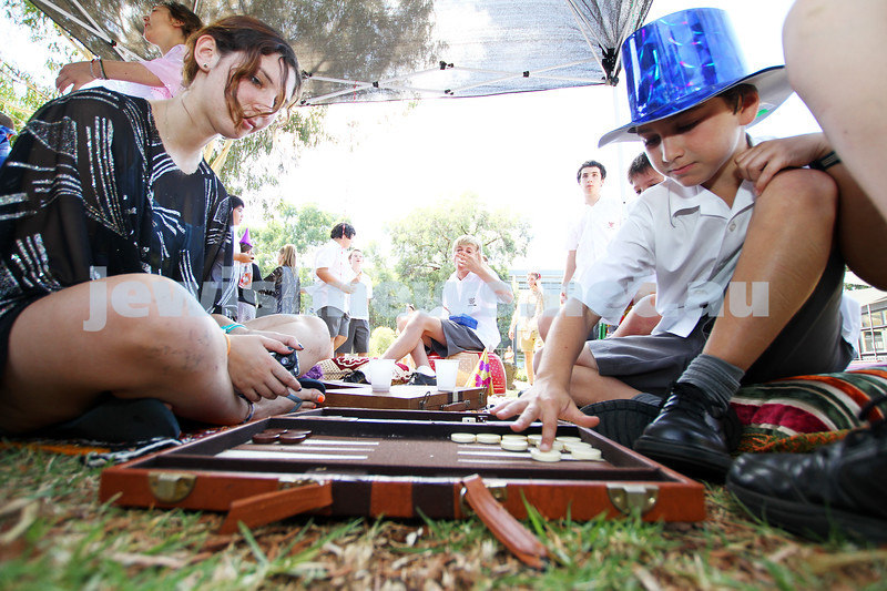 25-2-13. JSN/UJEB. Purim at Glen Eira College. Naomi Cherny playing backgammon with student Jordan Fried. Photo: Peter Haskin
