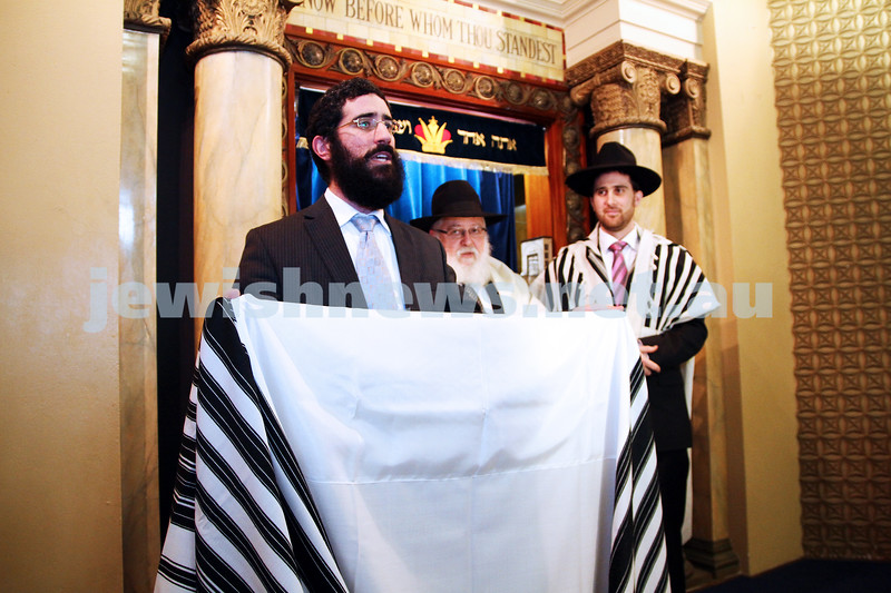 14-8-11. Induction of Rabbi Yaakov Glasman. Rabbi Yaakov Glasman receives tallas as the new rabbi of St Kilda Shul. Watching on are Rabbis Philp Heilbrunn and Hillel Nagel. Photo: Peter Haskin