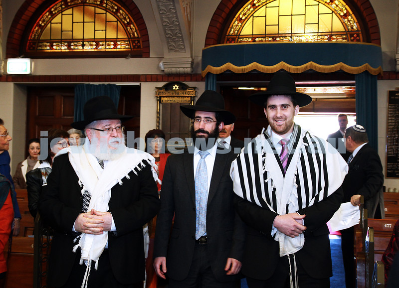 14-8-11. Rabbi Yaakov Glasman (centre) is led into St Kilda Shul for his induction ceremony as new Chief Minister. Flanked by the retiring Rabbi Philip Heilbrunn (left) and Rabbi Hillel Nagel. Photo: Peter Haskin