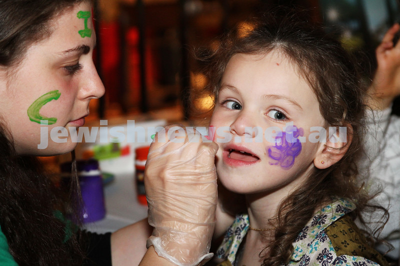 3-10-12. Chabad Youth. Succot at Luna Park, Melbourne. Aliza Houseman enjoys having her face painted. Photo: Peter Haskin