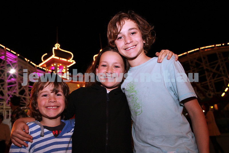3-10-12. Chabad Youth. Succot at Luna Park, Melbourne. From left: Boaz, Timna and Benji Gore. Photo: Peter Haskin