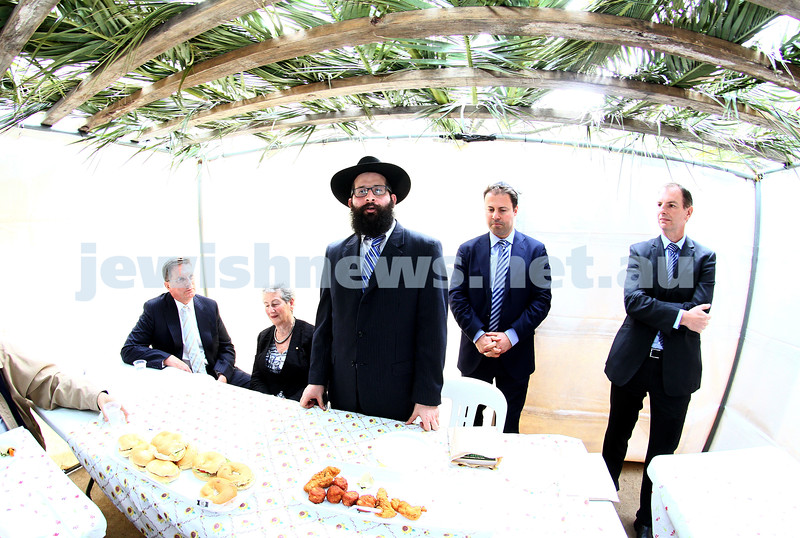24-9-13. Succot in the Melbourne CBD. Chabad of Melbourne hosting lunch in their succah in the City Square. From left: Ted Baillieu Nina Bassat, Rabbi Chaim Herzog, Josh Frydenberg, David Southwick. Photo: Peter Haskin