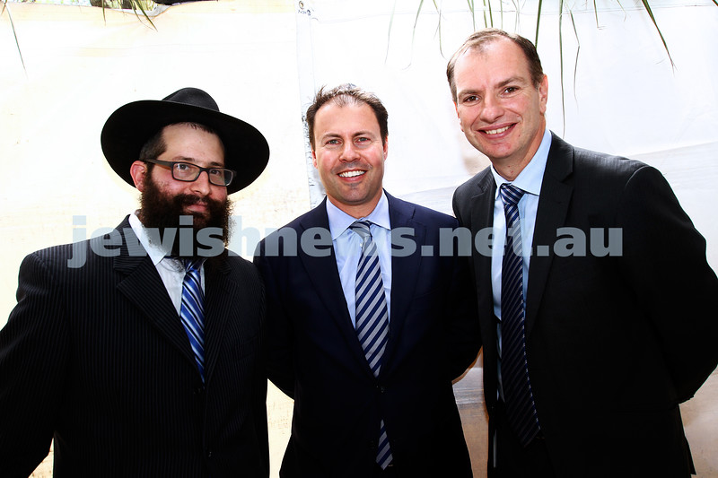 24-9-13. Succot in the Melbourne CBD. Chabad of Melbourne hosting lunch in their succah in the City Square. From left: Rabbi Chaim Herzog, Josh Frydenberg, David Southwick. Photo: Peter Haskin