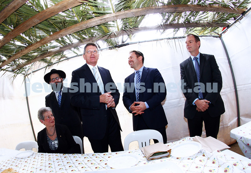 24-9-13. Succot in the Melbourne CBD. Chabad of Melbourne hosting lunch in their succah in the City Square. From left: Nina Bassat, Rabbi Chaim Herzog, Ted Bailieu, Josh Frydenberg, David Southwick. Photo: Peter Haskin