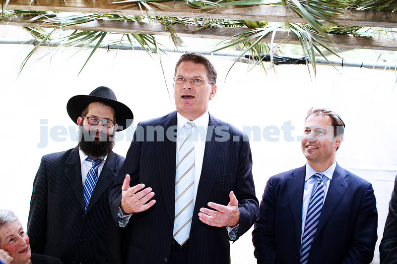 24-9-13. Succot in the Melbourne CBD. Chabad of Melbourne hosting lunch in their succah in the City Square. From left: Nina Bassat, Rabbi Chaim Herzog, Ted Bailieu, Josh Frydenberg, Photo: Peter Haskin