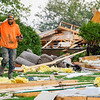 A man walks through debris while searching for personal items after a house exploded at 6223 E. Private Road 765 N. in Twelve Mile on Friday, Oct. 8, 2021.