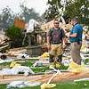 First responders walk through the yard of the home at 6223 E. Private Road 765 N. in Twelve Mile after it exploded on Friday, Oct. 8, 2021.
