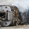 The Logansport Fire Department puts out the remaining flames inside the train car on Wednesday, June 23, 2021 in Logansport.