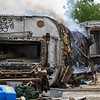 A train car that was going to be used for scrap metal sits on fire at One General St. on Wednesday, June 23, 2021 in Logansport.
