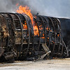 Flames come out of the roof of a train car on Wednesday, June 23, 2021 in Logansport.