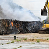 A train car at One General St. sits on fire on Wednesday, June 23, 2021 in Logansport. The car was to be used for scrap metal.