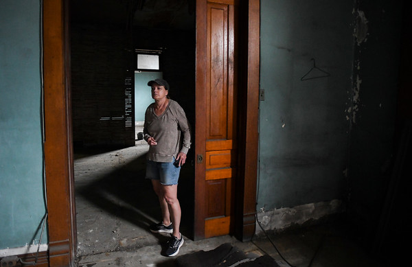 Amy Black shows off some of the rooms on the second floor of the building at 530 E. Broadway in Logansport on Tuesday, Sept. 21, 2021. They believe it used to house offices for lawyers.