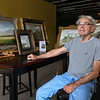 Gary Black poses with some of his paintings at 530 E. Broadway in Logansport on Tuesday, Sept. 21, 2021. Black said he'd like to have an artist's loft in one of the rooms so he can continue his work.