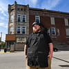 Andy Poyser poses in front of Bonus Pints in Logansport on Wednesday, Oct. 13, 2021. Poyser will be opening a barber shop above the bar.