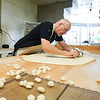 Randy Delrymple cuts the dough at Bolin's Donuts in Logansport on Friday, Oct. 8, 2021.